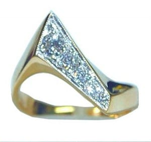 14 karat two tone diamond ring made by Gold In Art Jewelers.