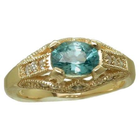 Blue Zircon Ring with 0.23 cttw. Diamonds